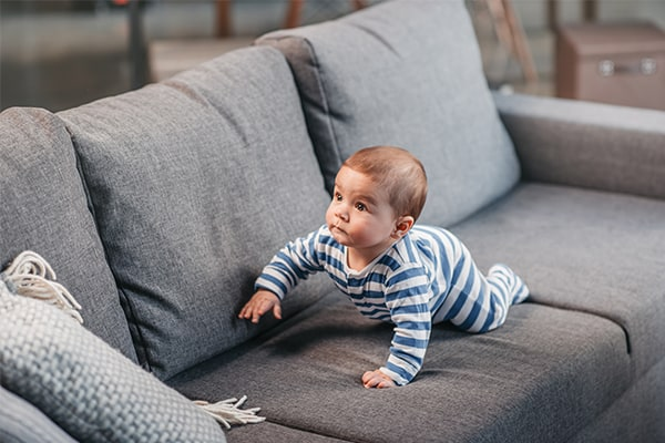 baby on grey sofa