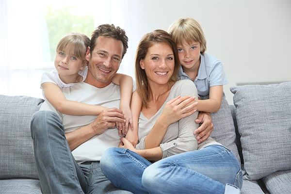 family on clean white sofa