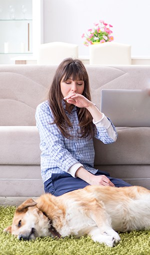 lady with smelly dog on carpet