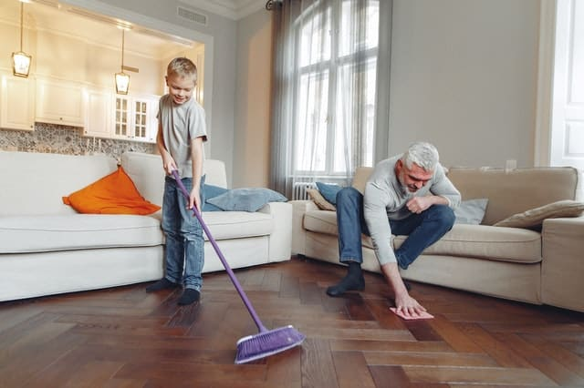A man and a boy cleaning a home